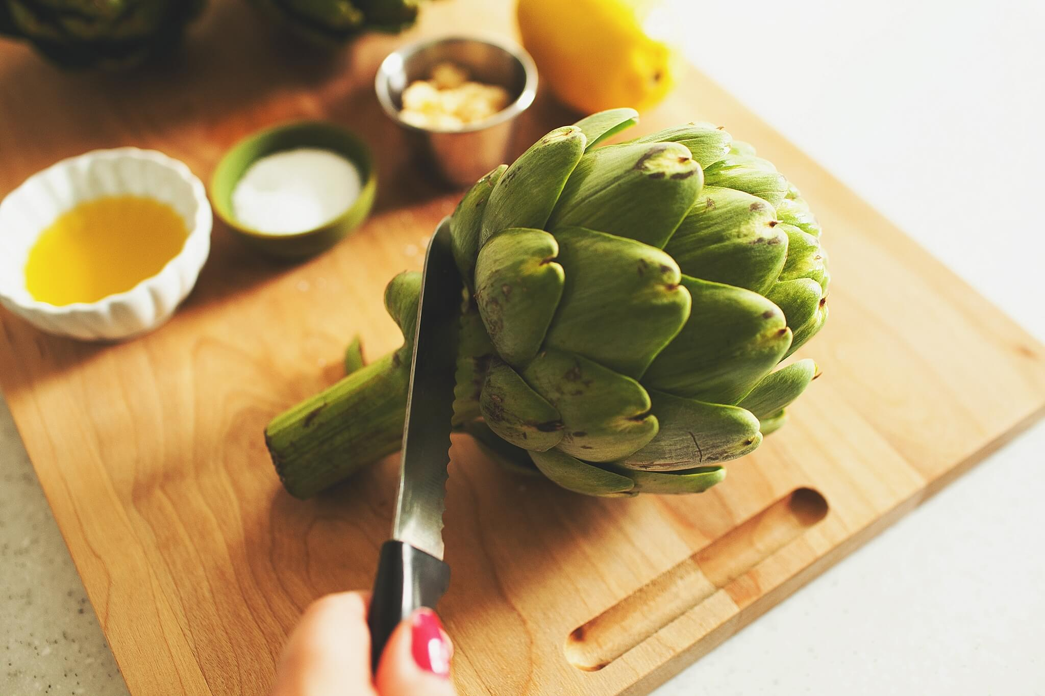 How to Cook Crockpot Artichokes: Step 2 trim stem