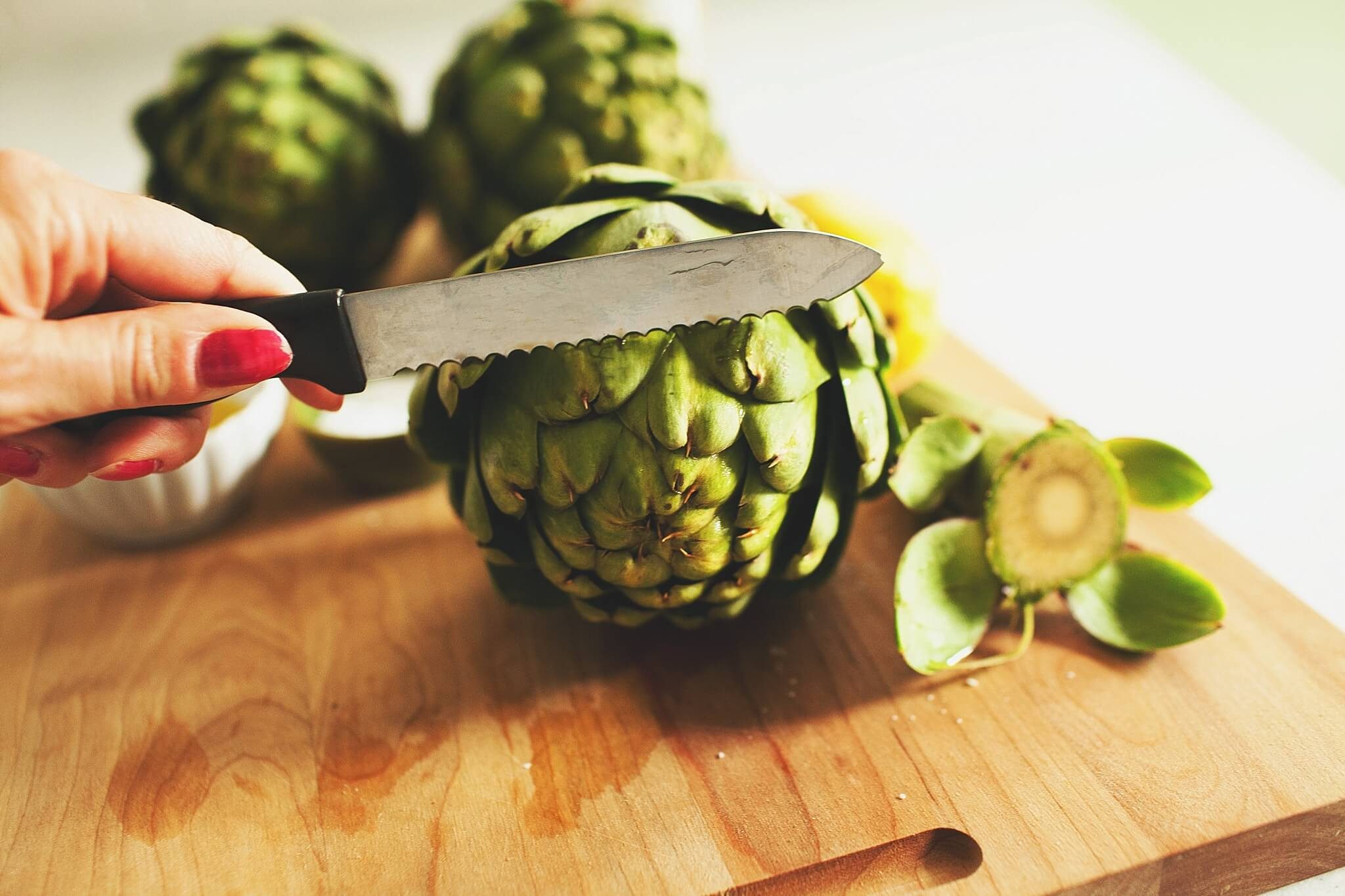 How to Cook Crockpot Artichokes - Step 3: trim the top