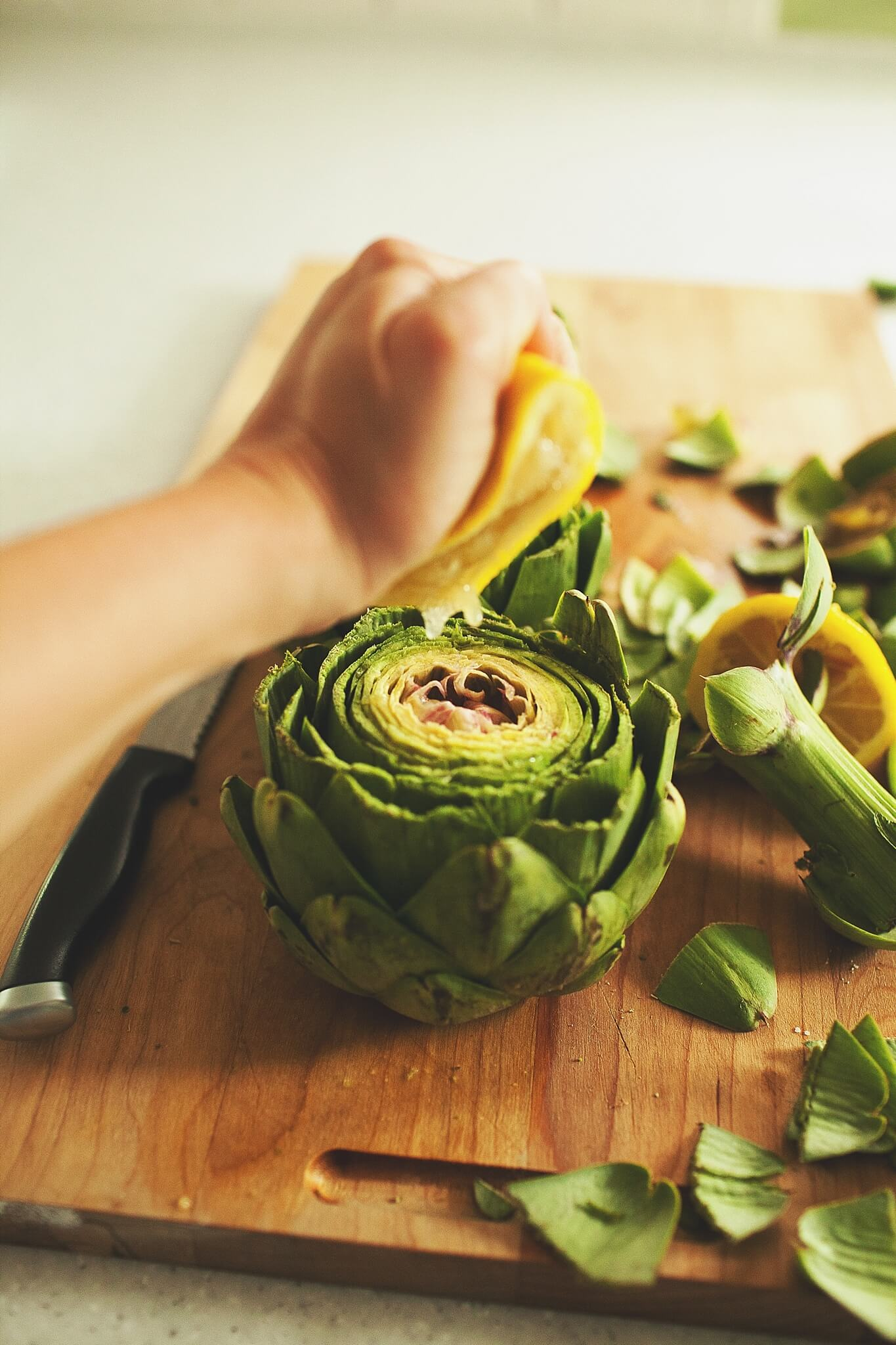 How to Cook Crockpot Artichokes - Step 6: squeeze lemon over artichokes