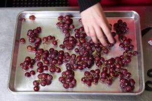 arrange single layer of grape clusters on baking sheet