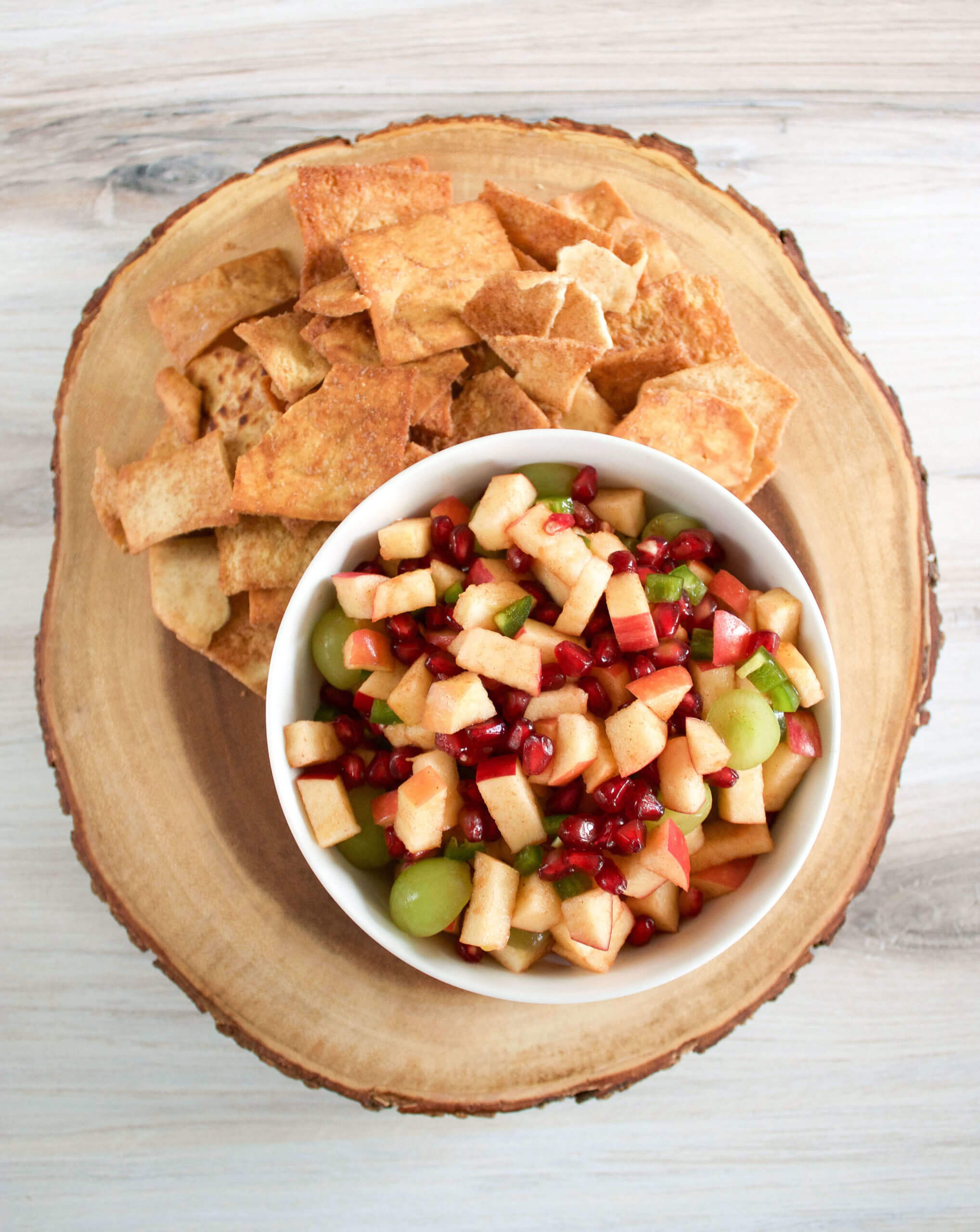 bowl of apple salsa with side of pita chips