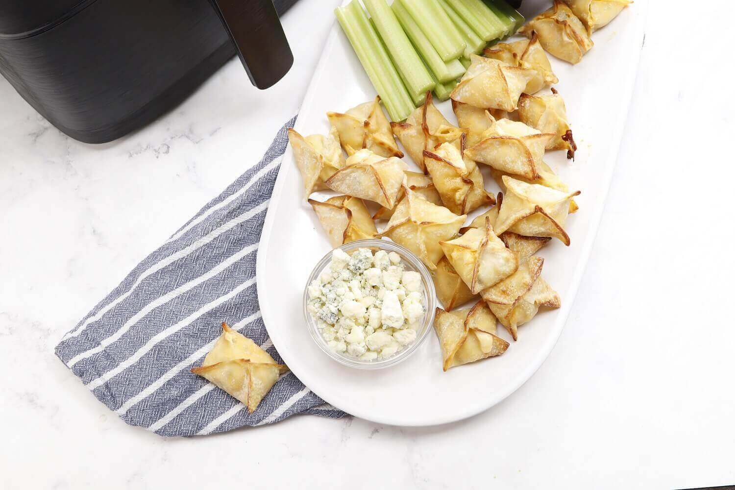 Crumbled blue cheese complements these wontons