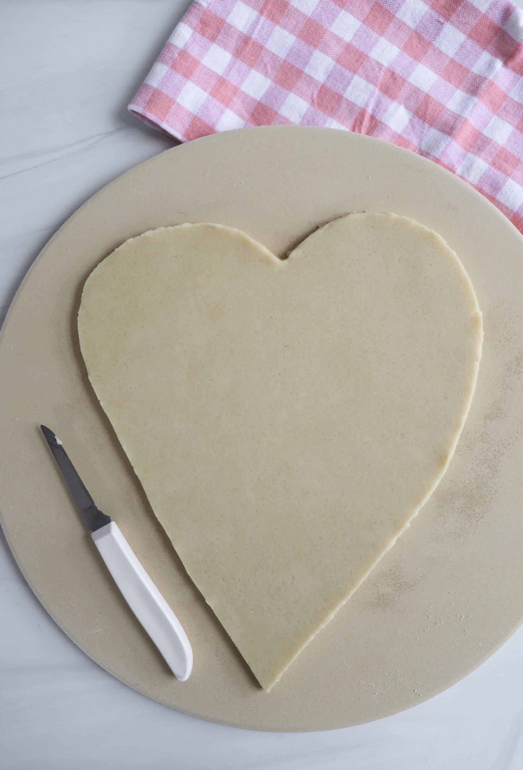 Making a heart-shaped pizza